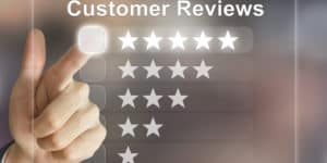 Business hand clicking on customer reviews on virtural screen interface